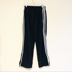 Adidas boys track pants with classic stripes